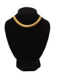 Härlig guld- halsband på skyltdockan som isoleras på vit royaltyfria foton