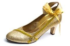 härlig guld- sko Arkivfoto