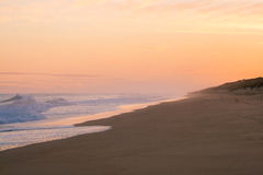 Härlig guld- soluppgång på 90 Miles Beach Royaltyfria Foton