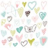 Härlig hand dragen uppsättning av olika hjärtor Doddle stil Uppsättning av valentinhjärtor för din design Arkivbilder