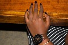 Härlig hand och klocka Arkivbild