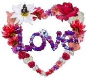 Härlig hjärta med legenden som göras av olika blommor Arkivbild