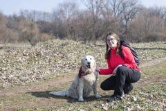 Härlig hund i naturen med kvinnan royaltyfria foton