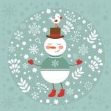 Härlig julkort med snögubben och fågeln Arkivfoto
