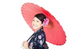 härlig kimonokvinna Arkivfoto