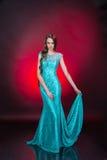 härlig klänningaftonflicka Arkivbild