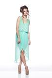 härlig klänningflickaturkos royaltyfri foto