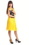 härlig klänningkvinnayellow Royaltyfria Bilder