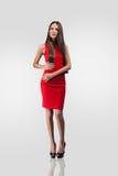 härlig klänningmodellred Arkivbilder