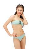 Härlig kvinna i bikini arkivbild