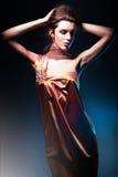 Härlig kvinna i lång klänning Arkivbild