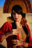 Härlig kvinna i röd klänning på sand Royaltyfria Foton