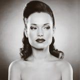 Härlig kvinna med aftonsmink Royaltyfria Bilder