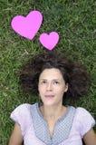 Härlig kvinna med hjärtor Arkivbild