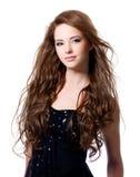 Härlig kvinna med långa hår Arkivbild