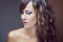 Härlig kvinna med makeup Arkivbild