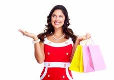 Härlig kvinna med påsar för en shopping. Royaltyfri Fotografi