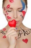 Härlig kvinna med smink på ämne av Frankrike Arkivfoton