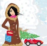 Härlig kvinna som gör shoppingen i vinter Arkivfoton