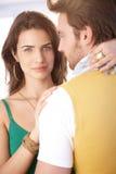 Härlig kvinna som kramar mannen arkivbild