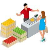 Härlig kvinna som shoppar nya frukter Fruktsäljare i en bondemarknad Ställning för att sälja frukt Spjällåda av äpplen, päron Royaltyfri Bild