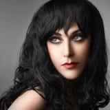 Härlig kvinnabrunettframsida royaltyfri foto