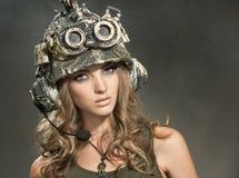 Härlig kvinnakrigare i en hjälm Fotografering för Bildbyråer