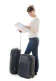 Härlig kvinnaturist med resväskor och översikten Arkivbild