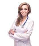 Härlig kvinnlig som ler den isolerade doktorn fotografering för bildbyråer