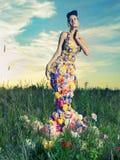 Härlig lady i klänning av blommor Royaltyfri Fotografi