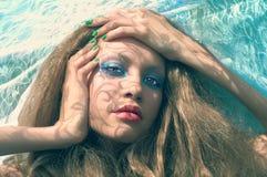 Härlig lady och sun'sens strålar Fotografering för Bildbyråer