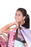 Härlig latinamerikansk kvinna med xmas-shoppingpåsar Arkivfoton