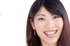 Härlig le asiatisk kvinna arkivbild