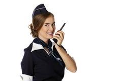 Härlig le stewardess med cbradion Arkivbild