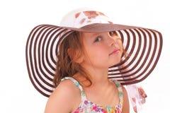 Härlig liten flicka i en hatt Arkivfoton