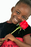 Härlig liten flicka med den röda rosen Fotografering för Bildbyråer