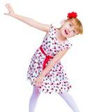 Härlig liten flicka med en leendebanhoppning Arkivfoto