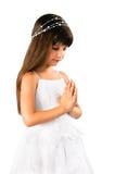 Härlig liten flicka som ber på white Fotografering för Bildbyråer