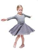 Härlig liten flicka som rotera omkring isolerat royaltyfri foto