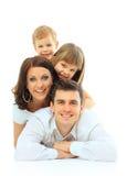 Härlig lycklig familj arkivfoton