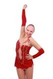 Härlig lycklig flickagymnastvinnare med den över huvudet handen royaltyfri foto