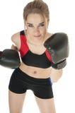 Härlig lycklig idrotts- flicka som ha på sig boxninghandskar. Arkivbilder