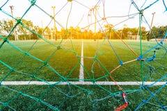 härlig modell av nytt grönt gräs för fotbollsporten, footb Arkivfoto
