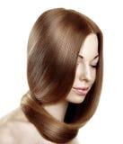 Härlig modell med sunt skinande långt hår Lyxigt H för skönhet Arkivfoton