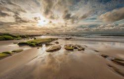 härlig molnig sky för strand Arkivfoto