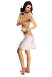 Härlig naken kvinna som applicerar hudkräm Arkivfoton