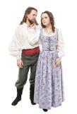 Härlig parkvinna och man i isolerad medeltida kläder Arkivbild