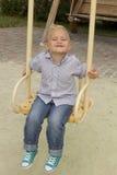 Härlig pojke i le för lekplats Royaltyfria Bilder