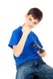 Härlig pojke med en styrspak arkivfoto