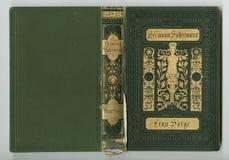 Härlig räkning av en tappningbok med den guld- blom- ramen en tom etikett för din text Arkivbild